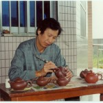 Working on a Zi Sha Hu (brown earthen teapot) in Yixing